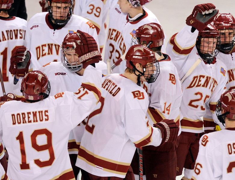 . The Pioneers celebrated the win at the conclusion of the game. The University of Denver hockey team defeated Cornell 2-1 at Magness Arena Saturday night, January 5, 2013. Karl Gehring/The Denver Post