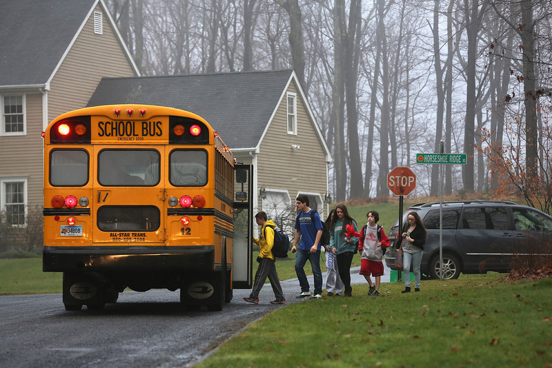 . Children return to school on December 18, 2012 in Newtown, Connecticut. Four days after 20 children and six adults were killed at Sandy Hook Elementary School, most students in Newtown returned to school. Children at Sandy Hook Elementary will attend a school in a neighboring town until authorities decide whether or not to reopen Sandy Hook. (Photo by John Moore/Getty Images)