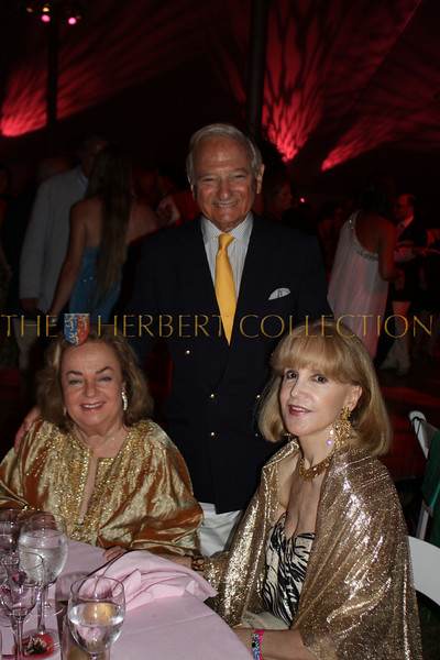 Dr. Frank Weiser and wife Myra on left, Gigi Fisdell on right