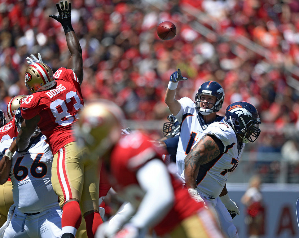 . Denver Broncos quarterback Peyton Manning (18) throws a pass over San Francisco 49ers tight end Demarcus Dobbs (83) during the first quarter  August 17, 2014 at Levi\'s Stadium. (Photo by John Leyba/The Denver Post)