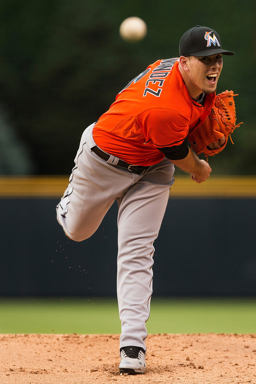 . Starting pitcher Jose Fernandez #16 of the Miami Marlins delivers to home plate during the first inning against the Colorado Rockies at Coors Field on July 23, 2013 in Denver, Colorado.  (Photo by Justin Edmonds/Getty Images)