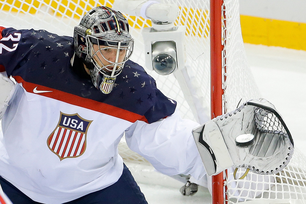 . USA goaltender Jonathan Quick catches a shot on the goal during the first period of men\'s quarterfinal hockey game against the Czech Republic in Shayba Arena at the 2014 Winter Olympics, Wednesday, Feb. 19, 2014, in Sochi, Russia. (AP Photo/Matt Slocum)