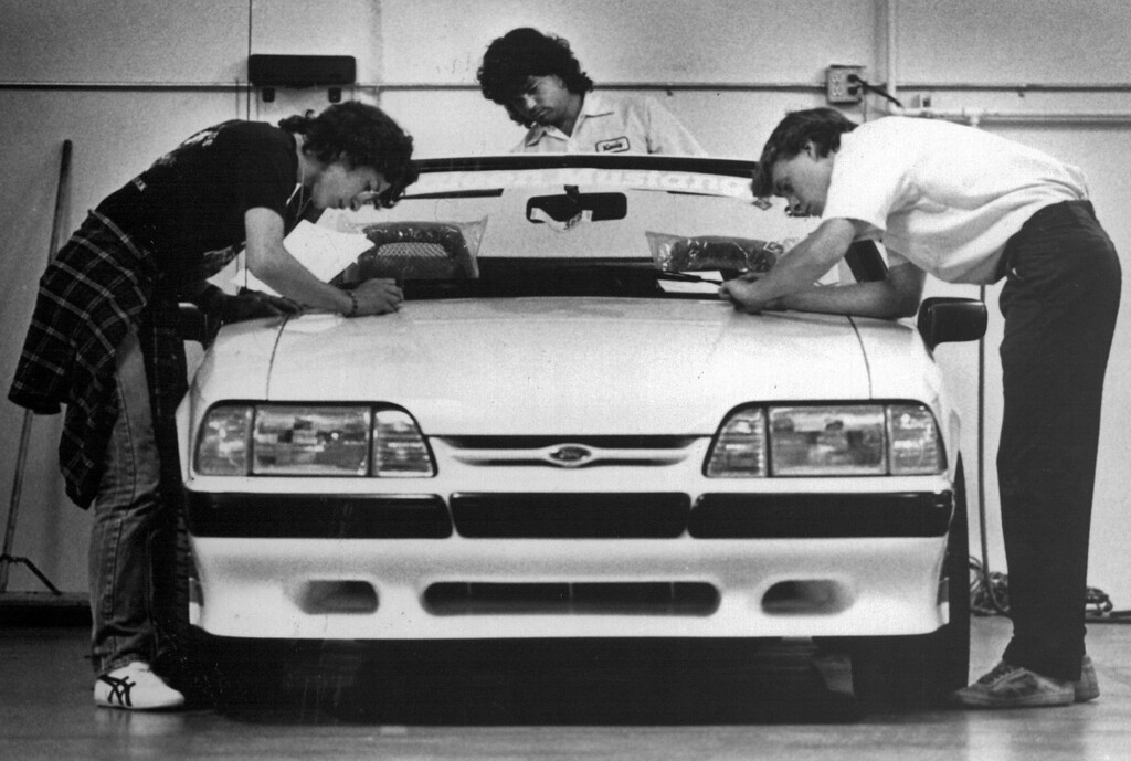 . Steve Saleen�s crew adds the finishing touches to the high-performance refinements that give an ordinary V-8 Mustang into what Car & Driver magazine describes as a take-no-prisoners street fighter.� Los Angeles Times Photo by Ken Hively)1988