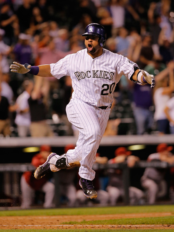 . DENVER, CO - SEPTEMBER 18:  Wilin Rosario #20 of the Colorado Rockies celebrates as he hit the game winning walk off two run home run off of Addison Reed #43 of the Arizona Diamondbacks at Coors Field on September 18, 2014 in Denver, Colorado. The Rockies defeated the Diamondbacks 7-6. (Photo by Doug Pensinger/Getty Images)