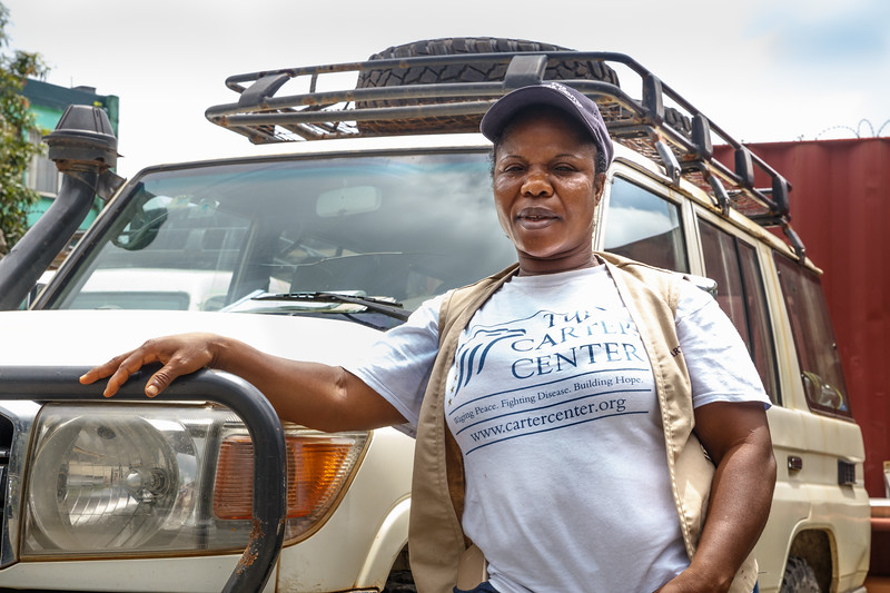 Monrovia, Liberia October 13, 2017 - Rosetta Quoime, driver for TCC and one of a few professional women drivers in Liberia, stands with a vehicle she drives.