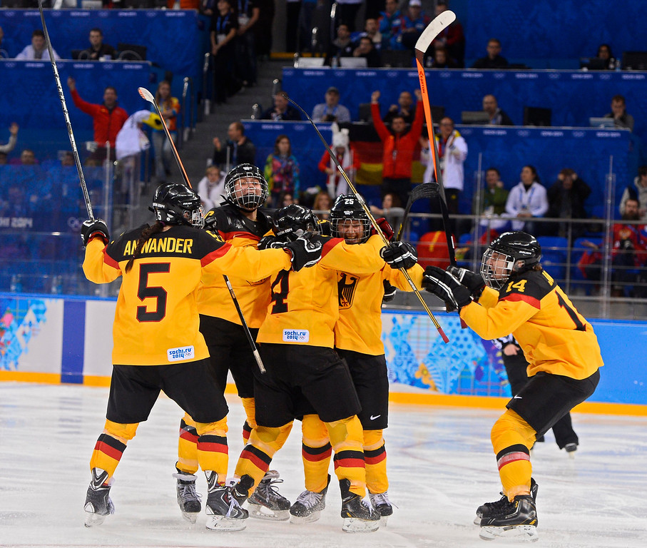 . Players celebrate with Franziska Busch (CR) of Germany after her goal against Russia in the second period during their match in the Ice Hockey tournament at the Sochi 2014 Olympic Games in Sochi, Russia, 09 February 2014.  EPA/LARRY W. SMITH