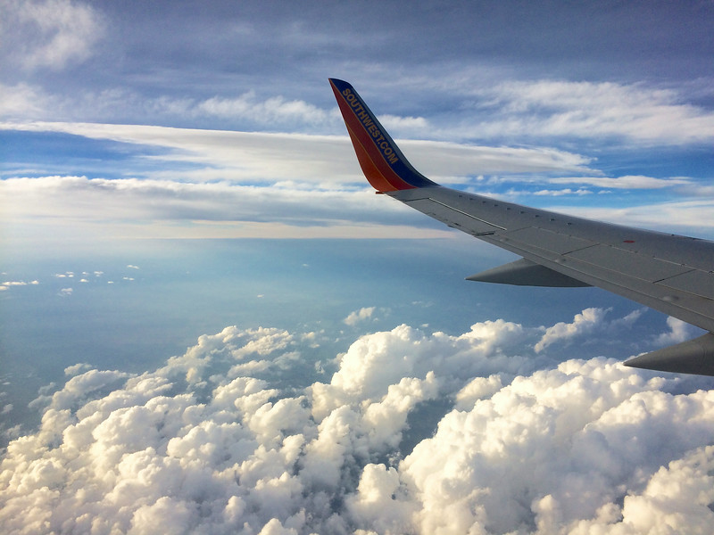 Looking out the window at the wing of a southwest airlines Boeing 737