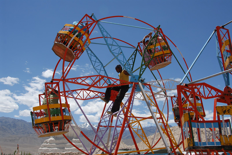 A human powered ferris wheel at the 800-year celebration of Shey Monastery in Ladakh, India