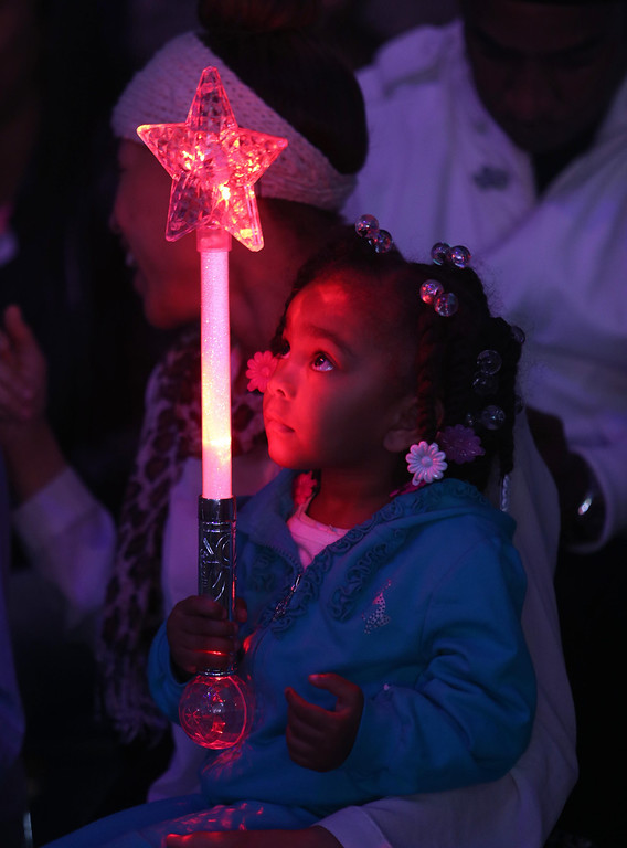 . Noelle Crain, 2, of Richmond, holds a lit star as the UniverSoul Circus performs under the big top on Hegenberger Road in Oakland, Calif., on Friday, April 5, 2013.  (Jane Tyska/Staff)