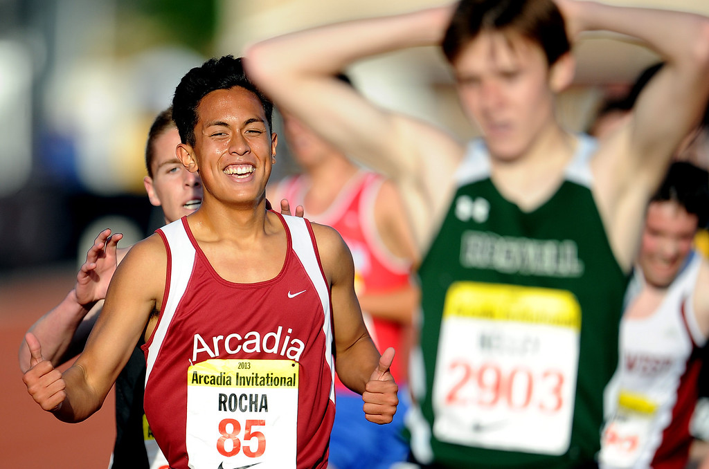 . Arcadia\'s Phillip Rocha finished second in the one mile run seeded race during the Arcadia Invitational at Arcadia High School on Saturday, April 6, 2013 in Arcadia, Calif.  (Keith Birmingham Pasadena Star-News)