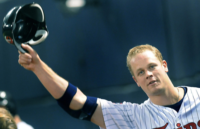. Twins hitter Justin Morneau doffs his helmet to the crowd after his seventh inning grand slam against the Milwaukee Brewers at the Metrodome in Minneapolis on Sunday, May 24, 2009.    (Pioneer Press: Richard Marshall)