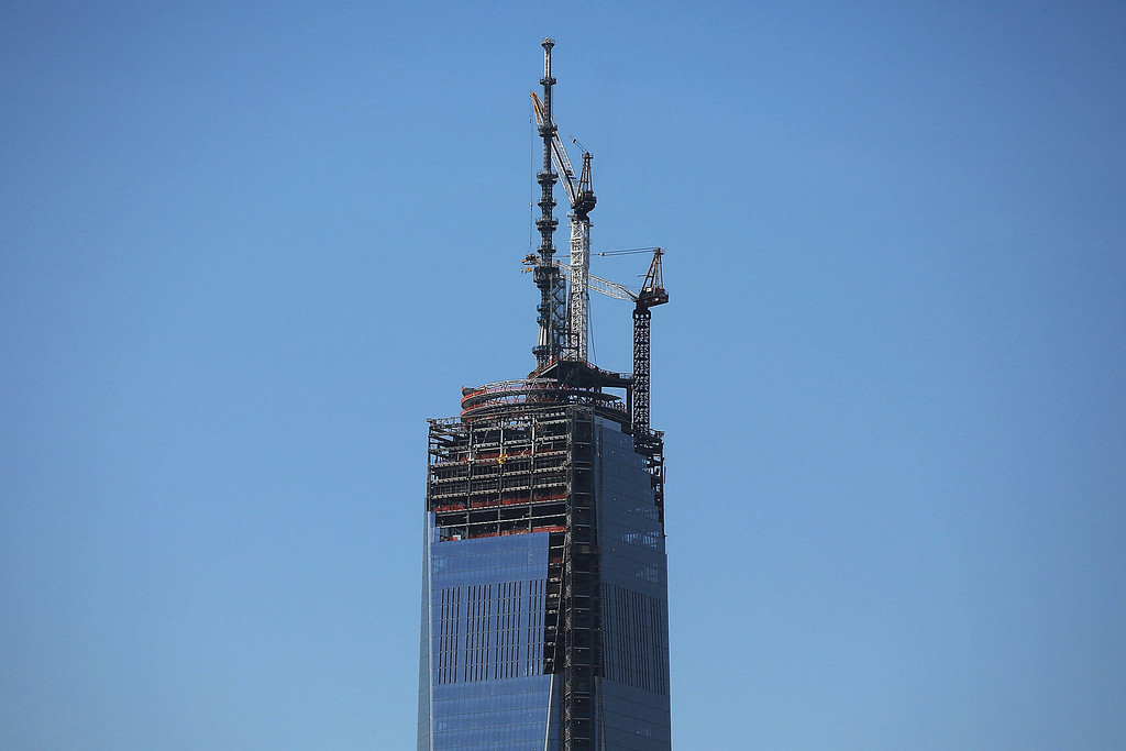 . The 408-foot spire is seen after it was hoisted onto a temporary platform on the top of One World Trade Center on May 2, 2013 in New York City. (Photo by Spencer Platt/Getty Images)