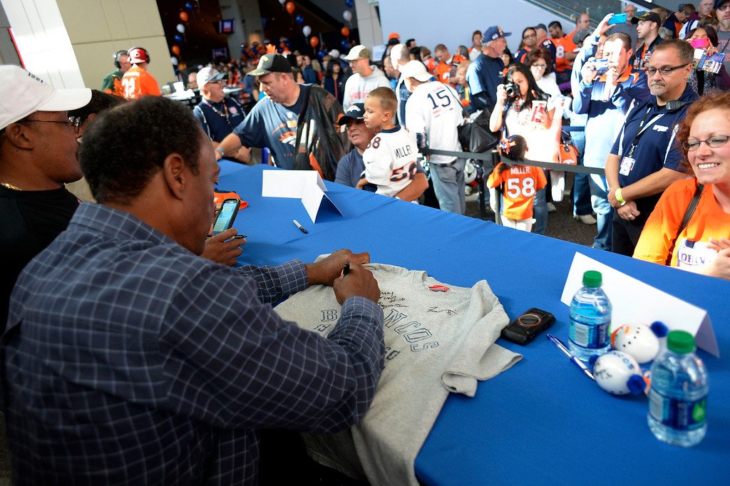 . DENVER, CO - OCTOBER 22: Former Denver Broncos Billy Thompson signs autographs for fans during the Denver Broncos and Bonfils Blood Center\'s 16th annual Drive for Life community blood drive October 22, 2013 at Sports Authority Field. (Photo by John Leyba/The Denver Post)