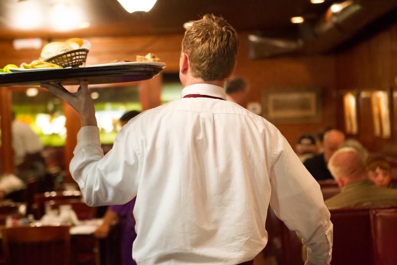 Jon Cordona serving food at Cattleman's Steak House in Oklahoma City.