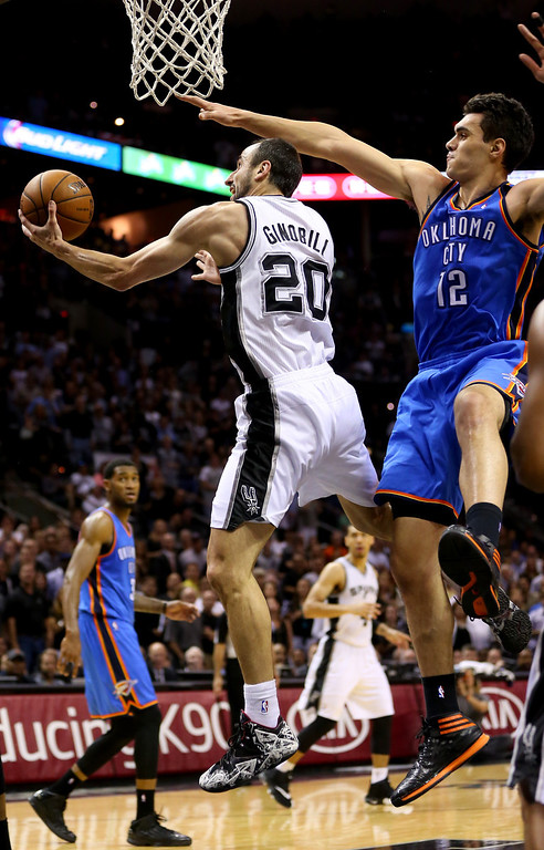 . Manu Ginobili #20 of the San Antonio Spurs goes up for a shot against Steven Adams #12 of the Oklahoma City Thunder in the first half in Game Two of the Western Conference Finals during the 2014 NBA Playoffs at AT&T Center on May 21, 2014 in San Antonio, Texas.   (Photo by Ronald Martinez/Getty Images)