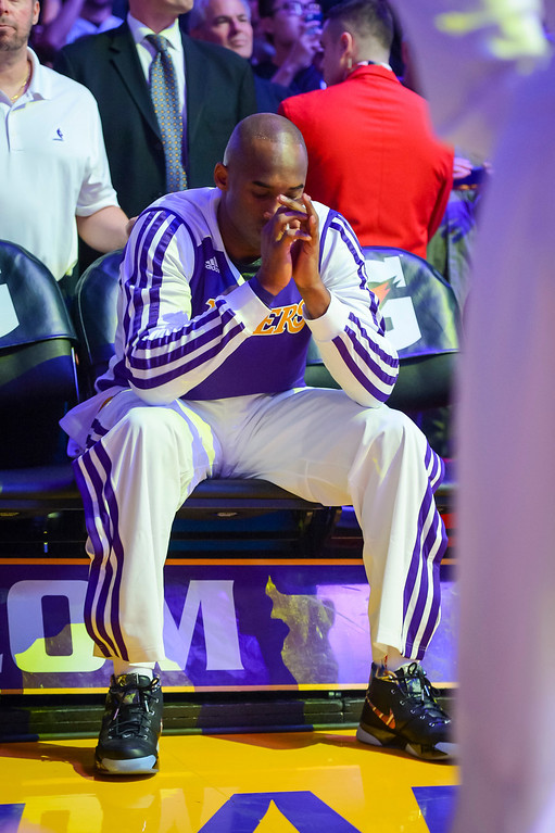 . Lakers� Kobe Bryant sits alone on the bench before being announced for the first time this season at Staples Center Sunday, December 8, 2013.   ( Photo by David Crane/Los Angeles Daily News )