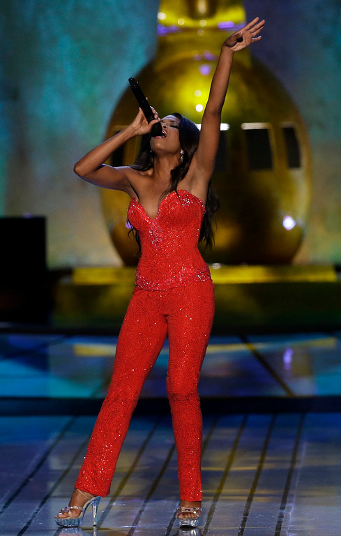 . Miss Mississippi Jasmine Murray sings during the talent portion of the Miss America 2015 pageant, Sunday, Sept. 14, 2014, in Atlantic City, N.J. (AP Photo/Mel Evans)