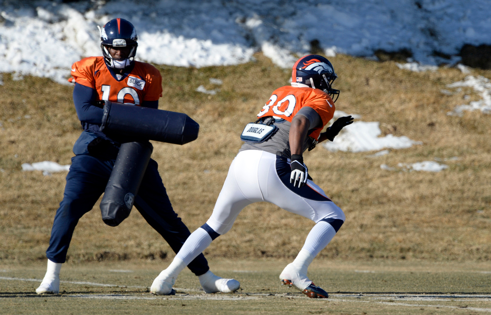 . Denver Broncos tight end Julius Thomas (80) runs through drills with Denver Broncos wide receiver Gerell Robinson (10) during practice January 8, 2014 at Dove Valley. The Denver Broncos are preparing for their Divisional Game against the San Diego Chargers at Sports Authority Field. (Photo by John Leyba/The Denver Post)