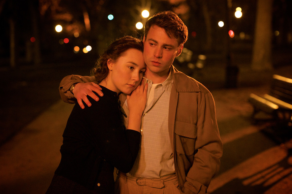 """. This photo provided by Fox Searchlight shows Saoirse Ronan, left, and Emory Cohen in a scene from the film, \""""Brooklyn.\"""" The 88th annual Academy Awards nominations will be announced on Thursday, Jan. 14, 2016, at the Academy of Motion Picture Arts and Sciences in Beverly Hills, Calif.  The Oscars will be presented on Feb. 28, 2016, in Los Angeles. (Kerry Brown/Fox Searchlight via AP)"""