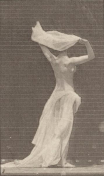 Semi-nude woman throwing handkerchief around shoulders