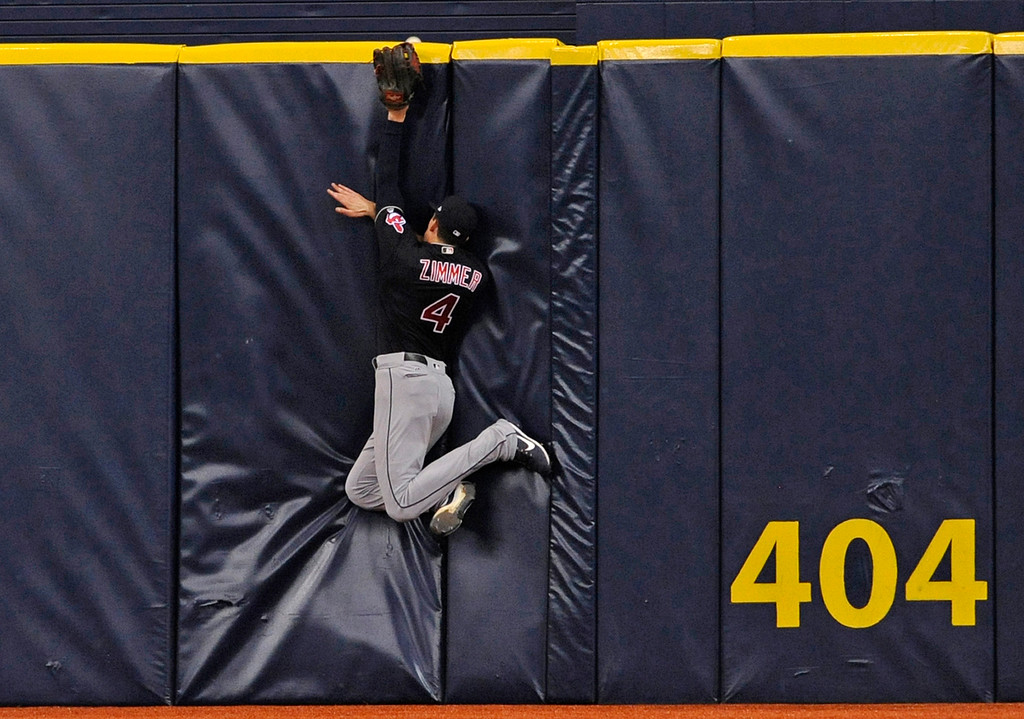 . Cleveland Indians center fielder Bradley Zimmer hits the padding as a three-run home run by Tampa Bay Rays\' Corey Dickerson slides over the wall during the eighth inning of a baseball game Thursday, Aug. 10, 2017, in St. Petersburg, Fla. (AP Photo/Steve Nesius)