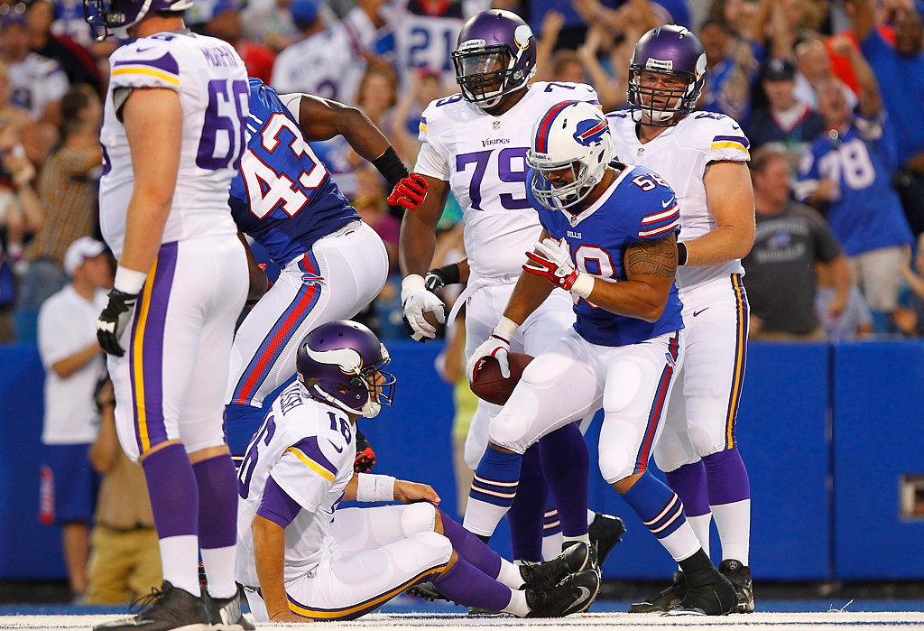 . Buffalo Bills\' Jamie Blatnick (58) celebrates after recovering a ball fumbled by Minnesota Vikings\' Matt Cassel (16) for a touchdown during the first half of an NFL preseason football game Friday, Aug. 16, 2013, in Orchard Park, N.Y.  (AP Photo/Bill Wippert)