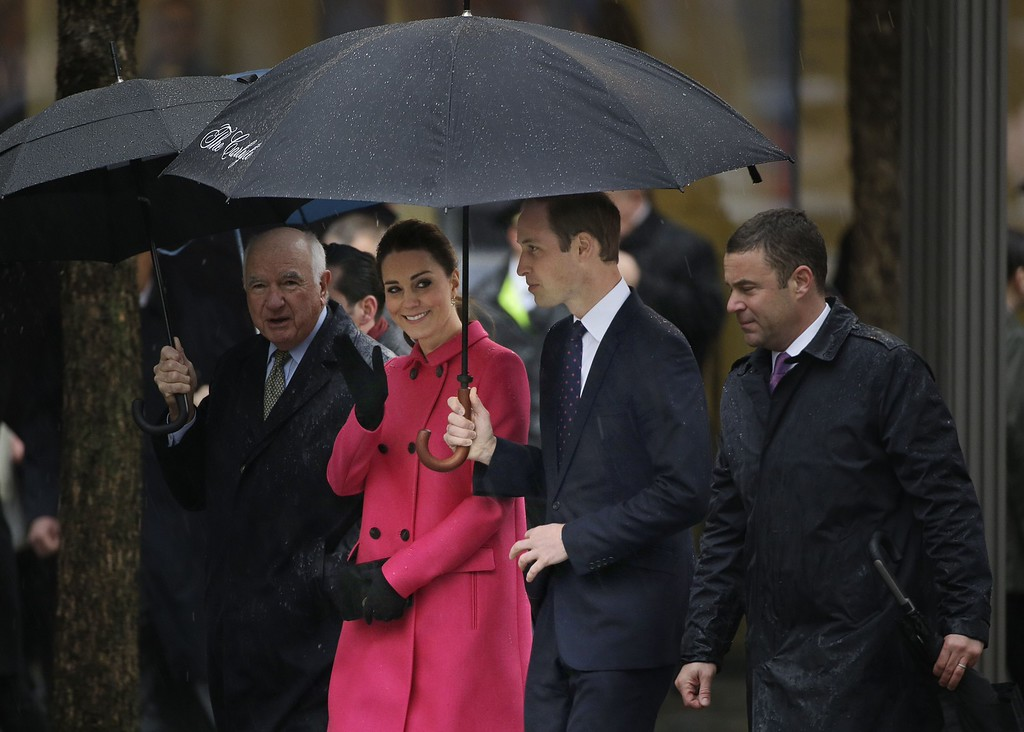 . Kate, Duchess of Cambridge, waves to fans as she and Britain\'s Prince William, second from left, are escorted into the 9/11 museum by its president, Joe Daniels, right, at the National Sept. 11 Memorial in New York, Tuesday, Dec. 9, 2014. (AP Photo/Seth Wenig)