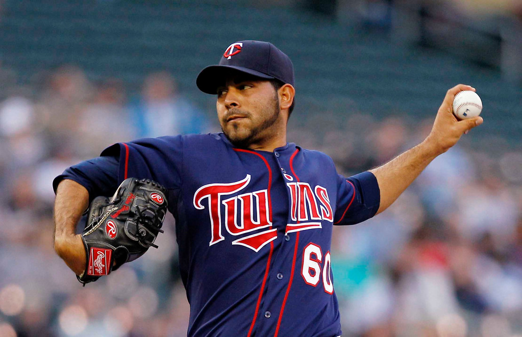 . Minnesota Twins starting pitcher Pedro Hernandez throws against the Chicago White Sox during the first inning of a baseball game, Monday, May 13, 2013, in Minneapolis. (AP Photo/Genevieve Ross)