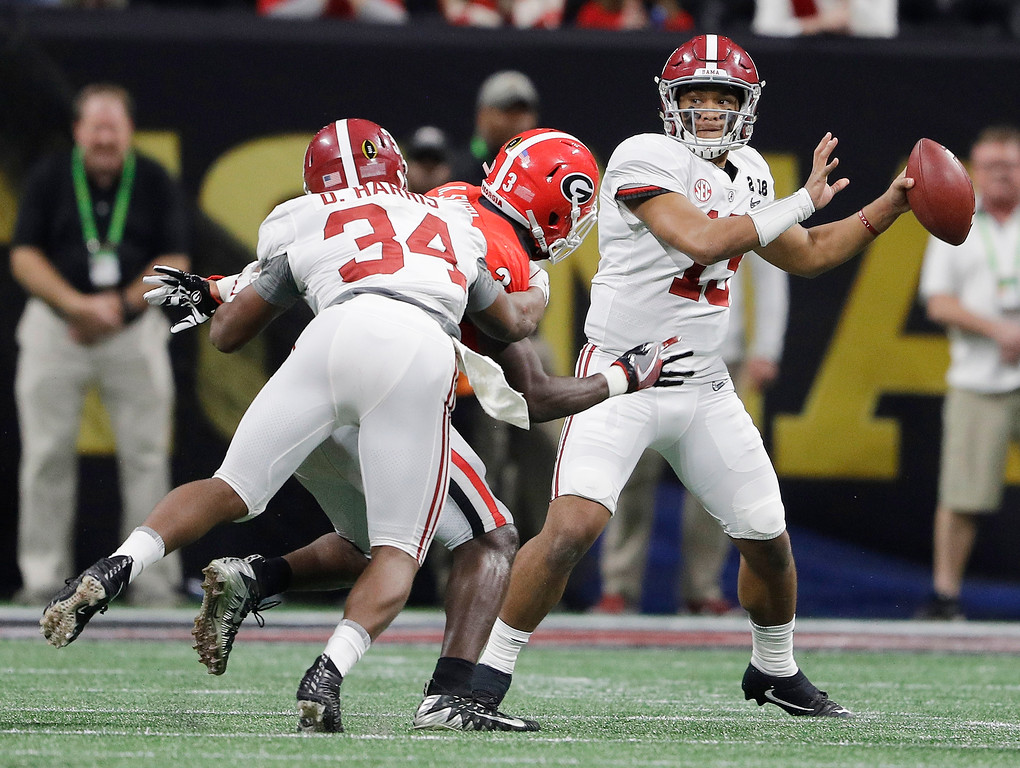 . Alabama quarterback Tua Tagovailoa drops back to pass during the second half of the NCAA college football playoff championship game against Georgia Monday, Jan. 8, 2018, in Atlanta. (AP Photo/David J. Phillip)