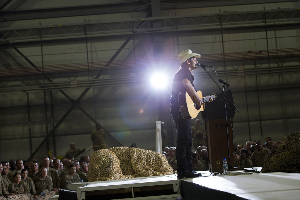 . Country music singer Brad Paisley performs during a troop rally with President Barack Obama during an unannounced visit at Bagram Air Field, on Sunday, May 25, 2014, north of Kabul, Afghanistan. (AP Photo/ Evan Vucci)