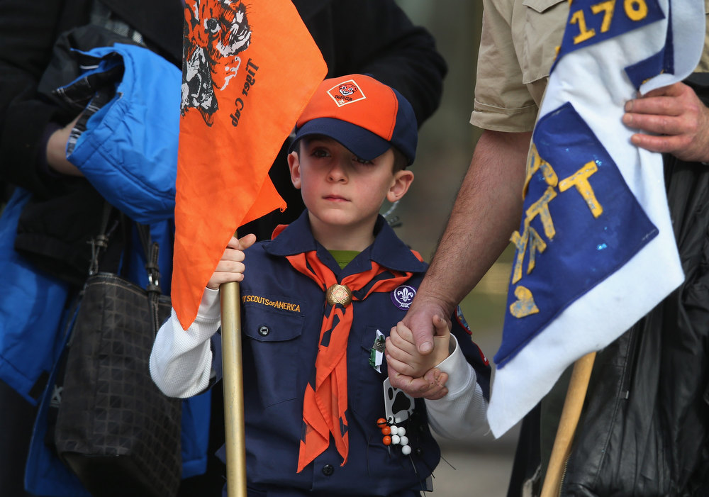. Mourners depart a funeral for Benjamin Wheeler, 6, at the Trinity Episcopal Church on December 20, 2012 in Newtown, Connecticut. Benjamin, a member of Tiger Scout Den 6, was killed when 20 children and six adults were massacred at Sandy Hook Elementary School last Friday. Six services were held for students and teachers in the Newtown area Thursday.  (Photo by John Moore/Getty Images)