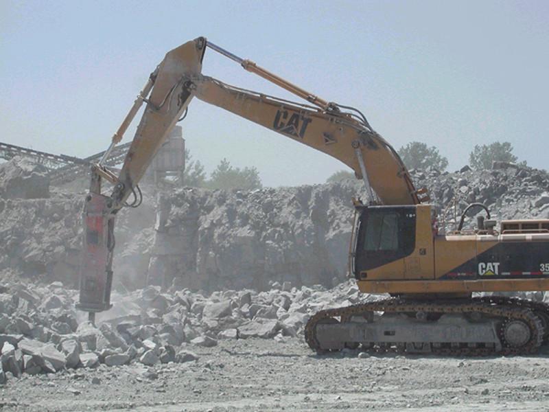 NPK E224A hydraulic hammer on Cat excavator.jpg
