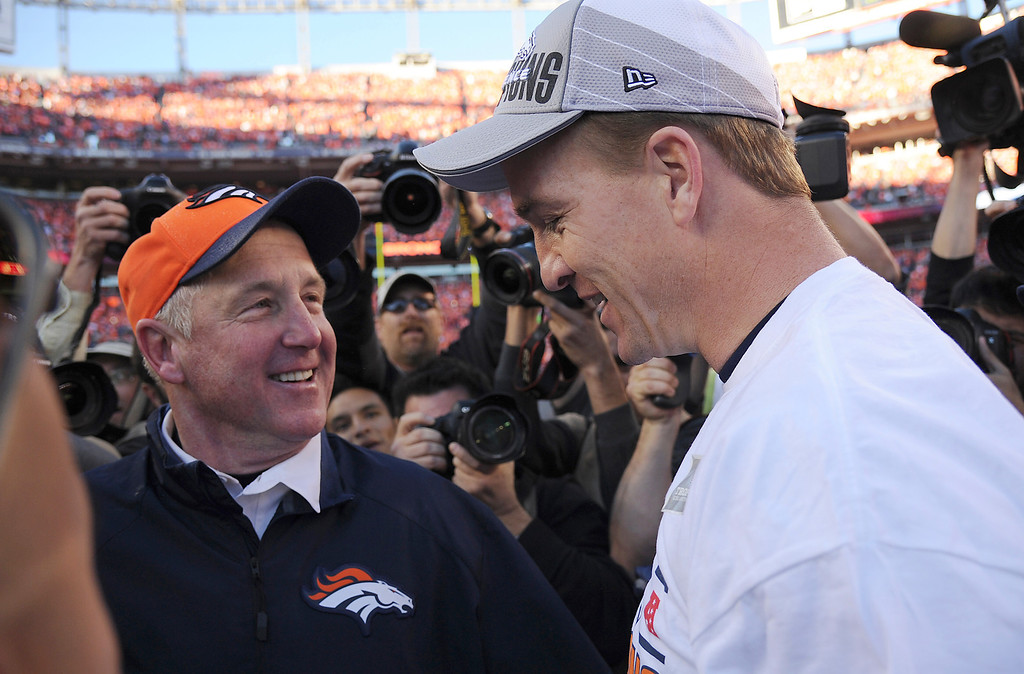 . Denver Broncos quarterback Peyton Manning (18) and Denver Broncos head coach John Fox after the Broncos beat the New England Patriots in the AFC Championship game at Sports Authority Field at Mile High in Denver on January 19, 2014. (Photo by Hyoung Chang/The Denver Post)