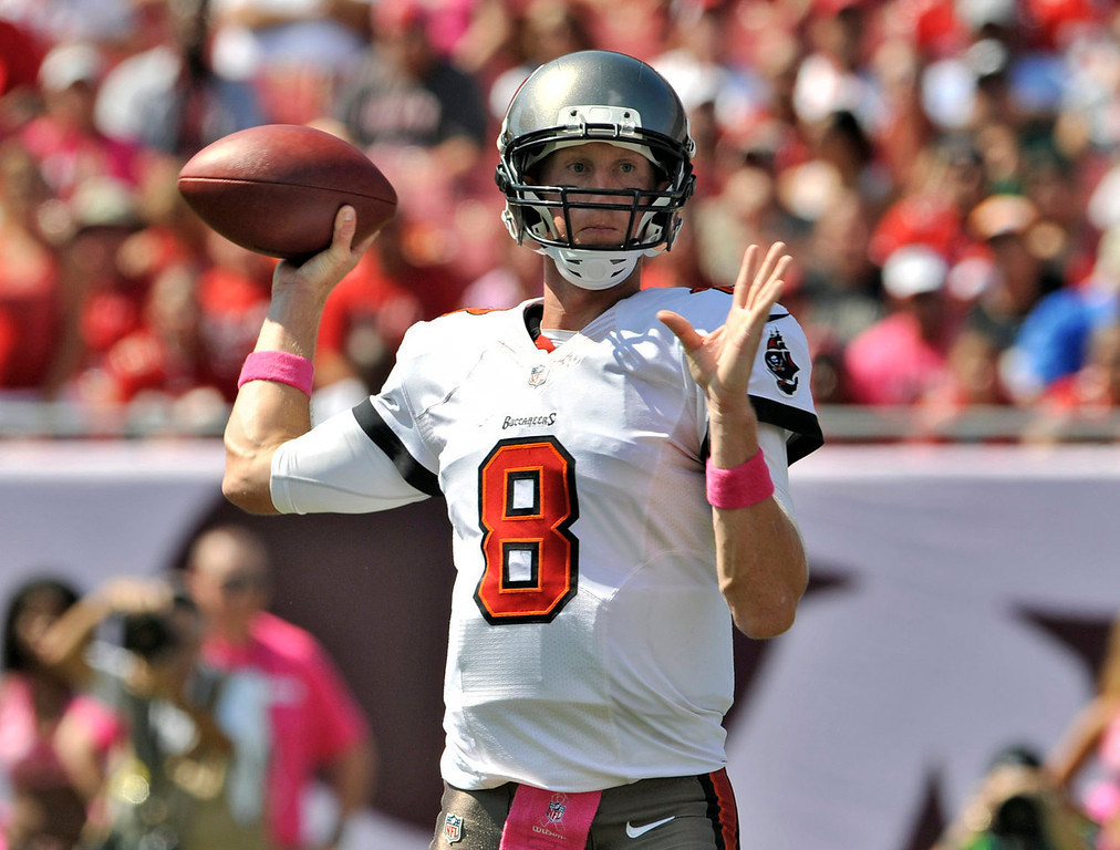 . Tampa Bay Buccaneers quarterback Mike Glennon (8) throws a pass against the Philadelphia Eagles during the first quarter of an NFL football game Sunday, Oct. 13, 2013, in Tampa, Fla. (AP Photo/Steve Nesius)