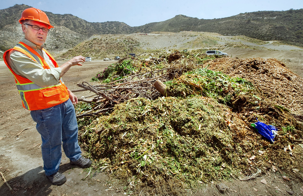 . Kreigh Hampel, Public Works Department Recycling Coordinator for Burbank Recycle Center discussing the process how the green waste is recycle into usable compost material. Burbank Wednesday, May 22, 2013. The new treatment of green waste is being used as alternative daily cover at the Puente Hills Landfill, but that is closing at end of October. So, not many other cities know what to do with the stuff you put out on your curb for separate pickup. Burbank Recycle Center has a huge operation moving 80 tons per day of green waste to a fertilzier/recycling facility in Fontana. (SGVN/Photo by Walt Mancini)