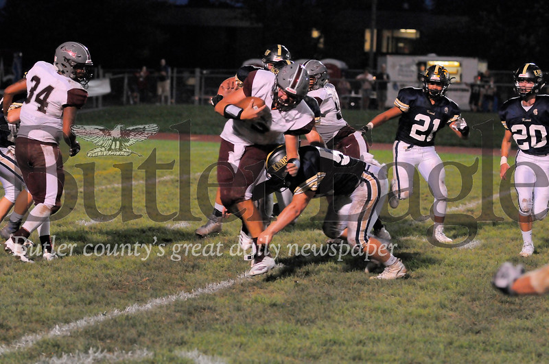 Ambridge #12 Mason Osborn is sacked by Knoch #59 Jarrett Bricker during a game at Knoch Stadium on Friday September 21, 2018. (Jason Swanson photo)