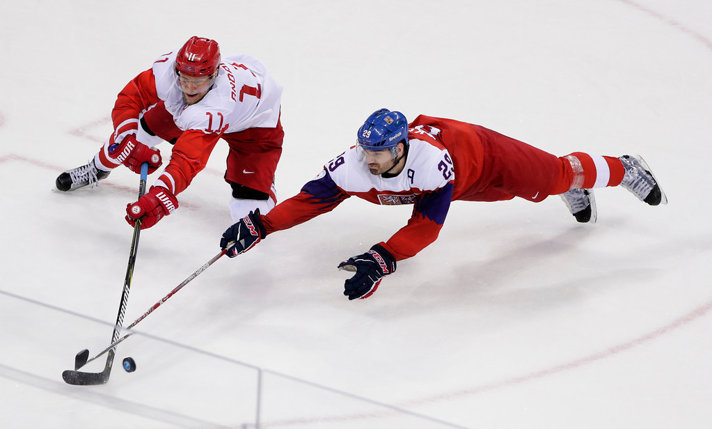 . Russian athlete Sergei Andronov (11) and Jan Kolar (29), of the Czech Republic, battle for the puck during the third period of the semifinal round of the men\'s hockey game at the 2018 Winter Olympics in Gangneung, South Korea, Friday, Feb. 23, 2018. (AP Photo/Frank Franklin II)
