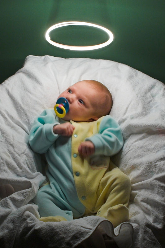 """Our Little Angel"" With binky in mouth, it took 62 exposures to get this one.  The binky was what was able to keep K.C. pacified as Dad whirled a mini-maglite on a string above his head.  We had to strike a fine balance between camera exposure time vs. time without fidgeting. (4x6 crop)"