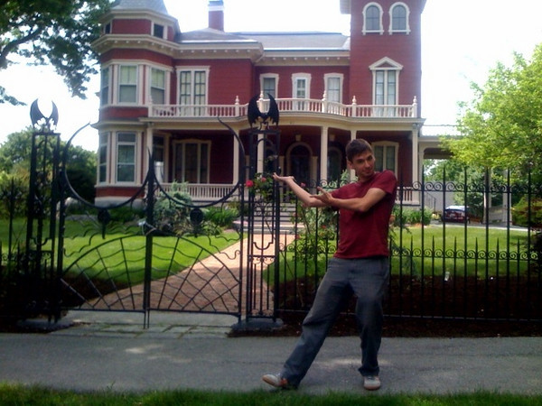 Ben in front of Stephen King's house.JPG