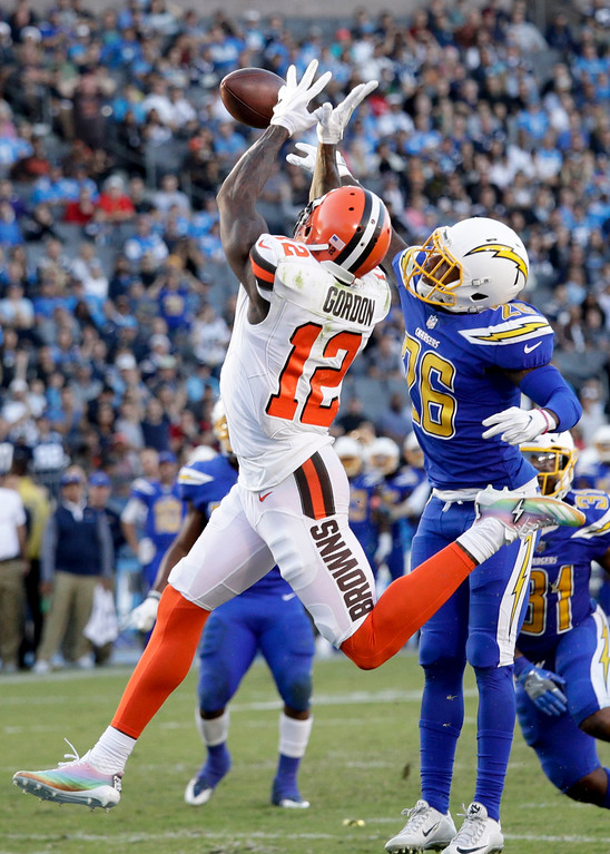 . Los Angeles Chargers cornerback Casey Hayward, right, breaks up a pass intended for Cleveland Browns wide receiver Josh Gordon during the second half of an NFL football game Sunday, Dec. 3, 2017, in Carson, Calif. (AP Photo/Jae C. Hong)