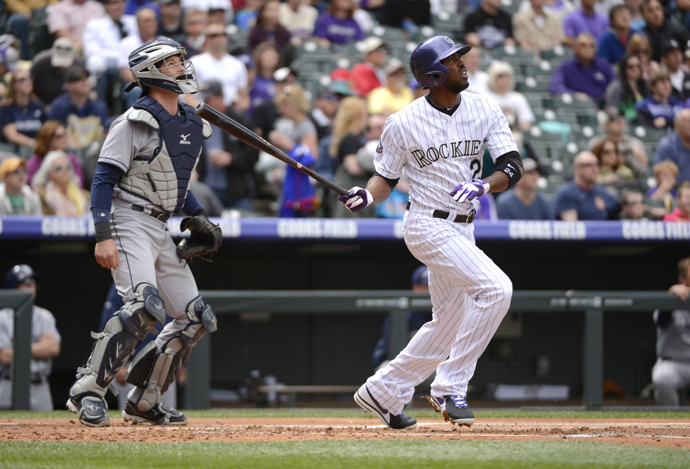 . Colorado Rockies Dexter Fowler (24) watches the ball sail over the wall for a two run home run in the first inning against the San Diego Padres April 7, 2013 at Coors Field. (Photo By John Leyba/The Denver Post)
