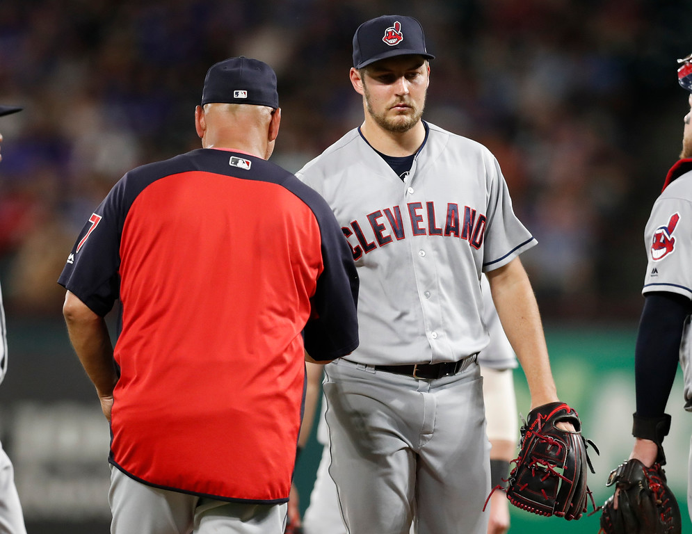 . Cleveland Indians starting pitcher Trevor Bauer, right, is relieved of his duties by manager Terry Francona, left, during the fifth inning of a baseball game against the Texas Rangers, Friday, July 20, 2018, in Arlington, Texas. (AP Photo/Jim Cowsert)