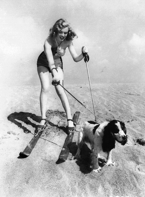 . In this January 1, 1947 file photo, starlet Marilyn Monroe plays at the beach with her dog Ruffles. (AP Photo, File)