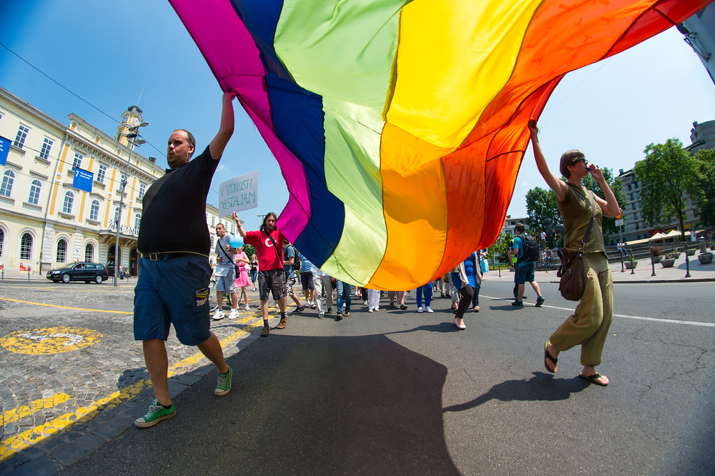 """. People hold a giant \""""rainbow\"""" flag during the Gay Pride Parade in Ljubljana, Slovenia, on June 15, 2013. AFP PHOTO / JURE  Makovec/AFP/Getty Images"""