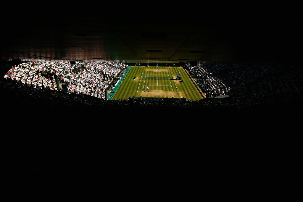 . General view of center court as Simona Halep of Romania serves during her Ladies\' Singles semi-final match against Eugenie Bouchard of Canada on day ten of the Wimbledon Lawn Tennis Championships at the All England Lawn Tennis and Croquet Club  on July 3, 2014 in London, England.  (Photo by Clive Brunskill/Getty Images)