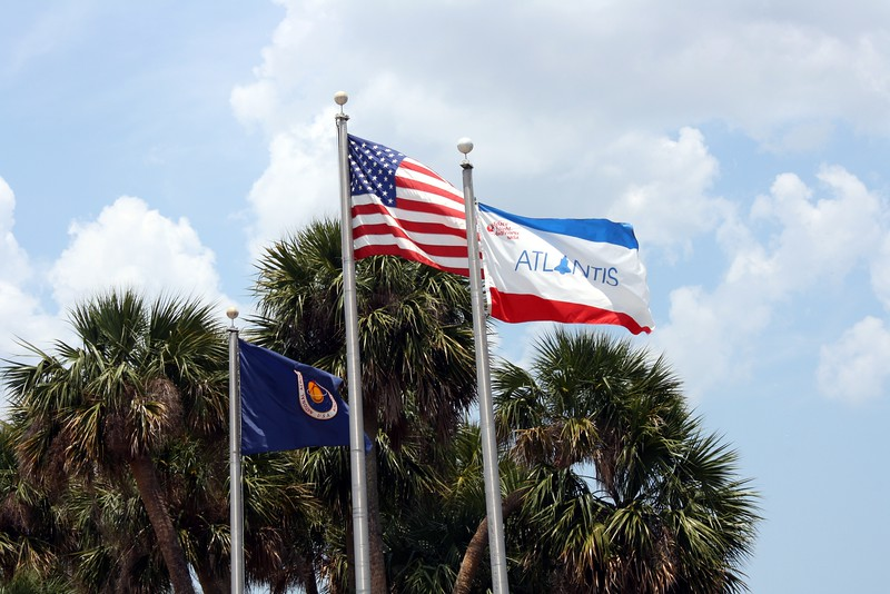 The flags of NASA, the United States, and Atlantis