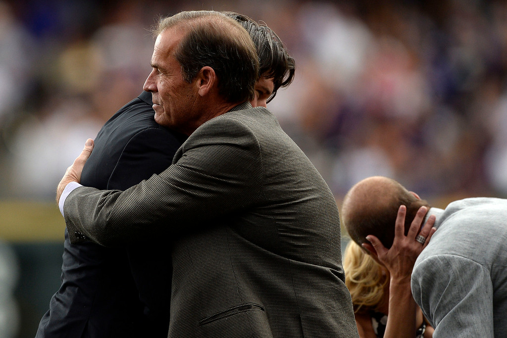 . Colorado Rockies great Todd Helton hugs owner Dick Monfort during a retirement ceremony for his number 17. Helton, who played 17 season with the Rockies and holds records for many of the organizations career statistics, was honored on Sunday, August 17, 2014. (Photo by AAron Ontiveroz/The Denver Post)
