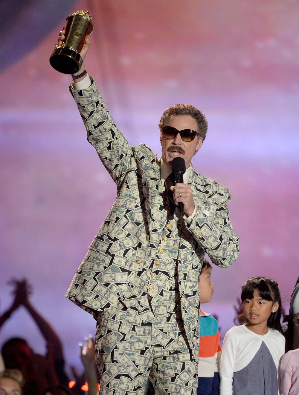 . Actor Will Ferrell accepts the Comedic Genius Award onstage during the 2013 MTV Movie Awards at Sony Pictures Studios on April 14, 2013 in Culver City, California.  (Photo by Kevork Djansezian/Getty Images)