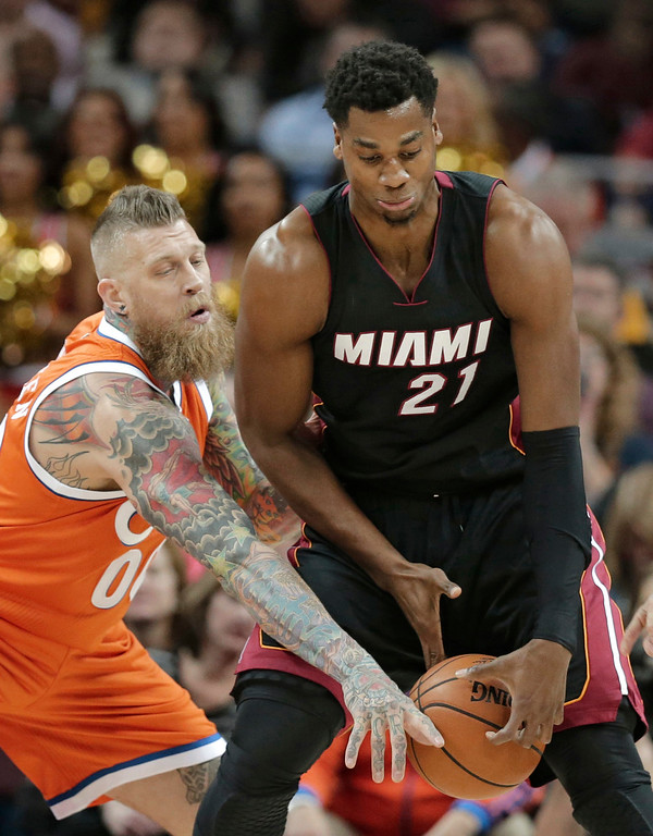 . Miami Heat\'s Hassan Whiteside (21) and Cleveland Cavaliers\' Chris Andersen (00) battle for the ball in the first half of an NBA basketball game Friday, Dec. 9, 2016, in Cleveland. The Cavaliers won 114-84. (AP Photo/Tony Dejak)
