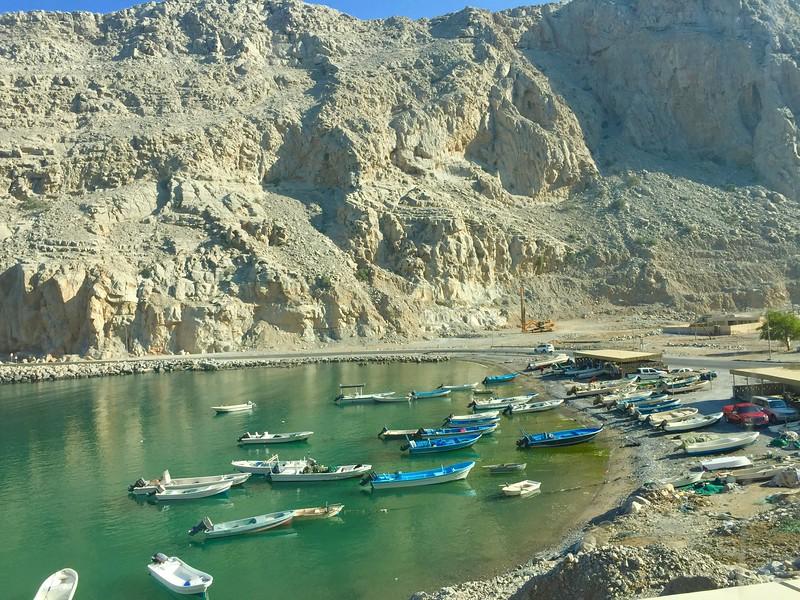 Boats in waiting on Oman's Musandam Peninsula - Bridget St. Clair